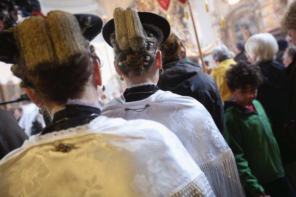 . Participants dressed in traditional Bavarian folk costumes attend the annual Corpus Christi (in German called Fronleichnam) mass at St. Michael\'s Church on May 30, 2013 in Seehausen am Staffelsee, Germany. The Seehausen Corpus Christi celebration usually includes a procession to a chapel across the nearby Staffelsee lake, though rain forced organizers to cancel the lake procession this year. Corpus Christi is among the highlights of the Catholic religious calendar in Bavaria.  (Photo by Sean Gallup/Getty Images)