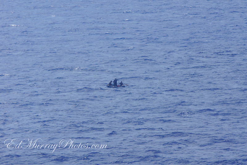 Their sail was taken down...as the Wonder circled the raft awaiting instructions from the Coast Guard