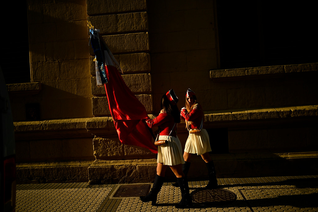 """. Two female \""""Tamborilleros\"""" wearing their uniforms march in the traditional \'La Tamborrada\', during \'El Dia Grande\', the main day of San Sebastian feasts, in the Basque city of San Sebastian, northern Spain, Friday, Jan. 20, 2017. From midnight to midnight companies of perfectly uniformed marchers parade through the streets of San Sebastian playing drums and barrels in honor of their patron saint. (AP Photo/Alvaro Barrientos)"""