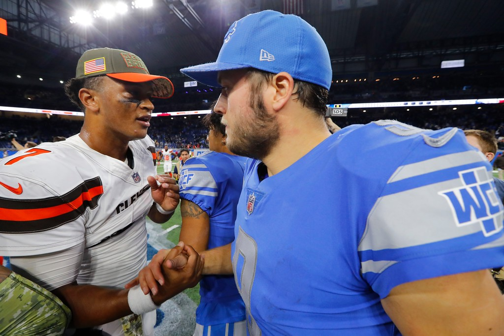 . Cleveland Browns quarterback DeShone Kizer (7) greets Detroit Lions quarterback Matthew Stafford (9) after their NFL football game, Sunday, Nov. 12, 2017, in Detroit. (AP Photo/Paul Sancya)