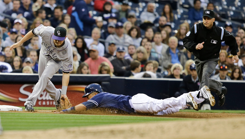 . Colorado Rockies third baseman Reid Brignac, left, puts tag on San Diego Padres\' Everth Cabrera who is out trying to steal third to end the third inning with another runner on-base during a baseball game on Saturday, April 13, 2013, in San Diego. (AP photo/Lenny Ignelzi)