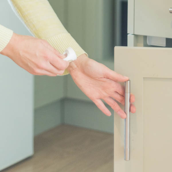 Fred_Home_Safety_Invisible_Magnet_Lock_Lifestyle_white_opening.jpg