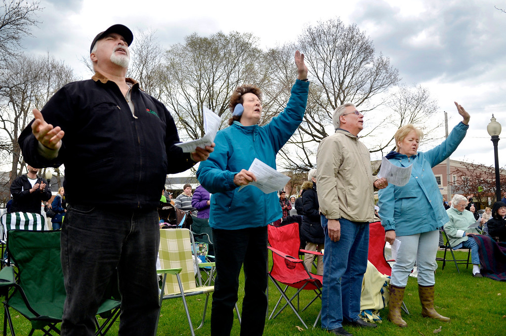 . Jeff Forman/JForman@News-Herald.com Mark Steffens, left, Joy Yommer and Bob and Jennifer Higgins participate in a National Day of Prayer observance May 1 in Painesville.