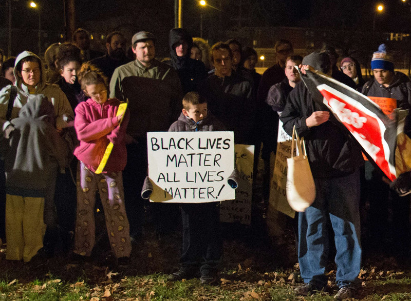 . People display signs at Cudell Commons Park in Cleveland, Ohio, November 24, 2014  during a rally for Tamir Rice, a 12-year-old boy shot by police on November 23. Cleveland police chief Calvin Williams on Monday defended the conduct of the officer who fatally shot the 12-year-old who was wielding a replica handgun. Tamir Rice died in hospital early Sunday after two police officers, responding to a 911 emergency call, confronted the African-American youngster at a recreation center. The incident came as Americans awaited a grand jury\'s decision on whether to indict a white police officer, Darren Wilson, in the St. Louis, Missouri suburb of Ferguson for the fatal shooting in August of black teenager Michael Brown.  JORDAN GONZALEZ/AFP/Getty Images