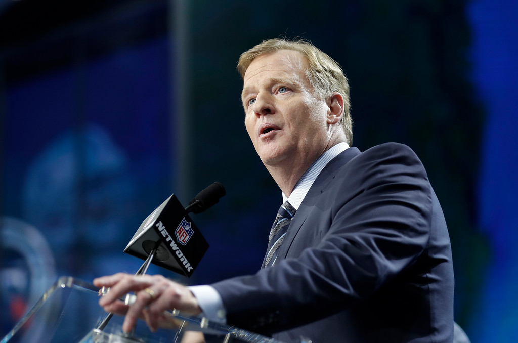 . NFL commissioner Roger Goodell speaks from the stage during the first round of the NFL football draft, Thursday, April 26, 2018, in Arlington, Texas. (AP Photo/David J. Phillip)