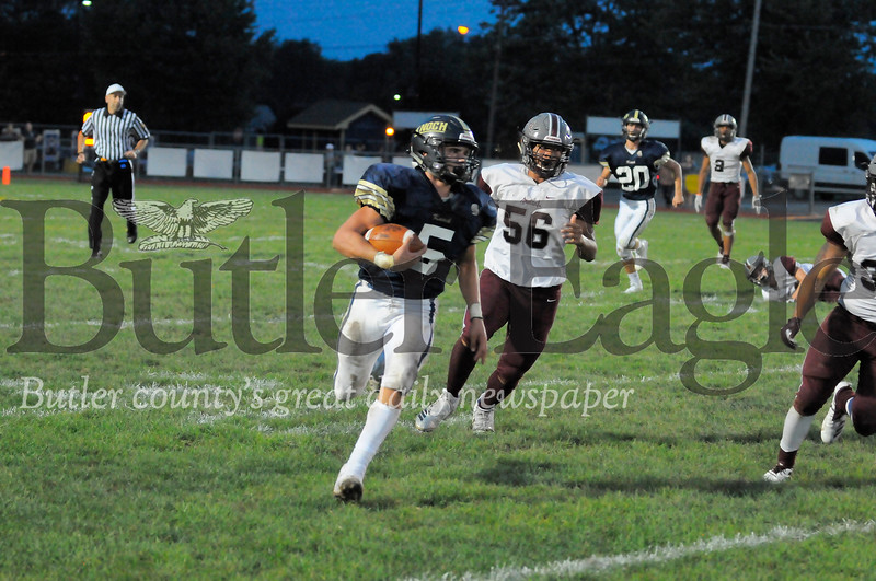Knock #5 Matt Goodlin runs past Ambridge #56 Makai Pringle during a game at Knoch Stadium on Friday September 21, 2018. (Jason Swanson photo)
