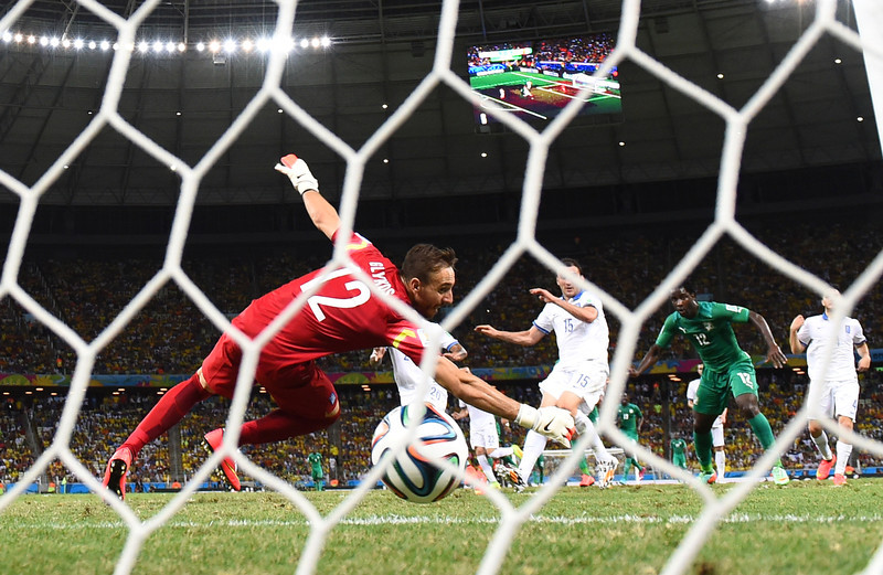 . Wilfried Bony of the Ivory Coast scores his team\'s first goal past Panagiotis Glykos of Greece during the 2014 FIFA World Cup Brazil Group C match between Greece and the Ivory Coast at Castelao on June 24, 2014 in Fortaleza, Brazil.  (Photo by Jamie McDonald/Getty Images)