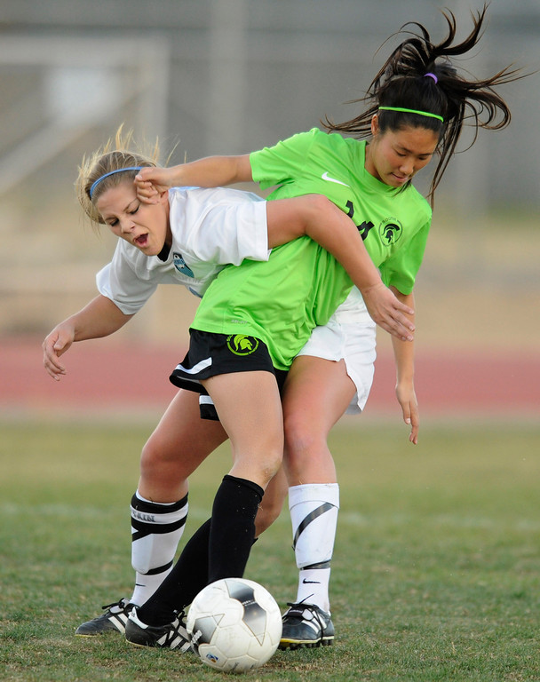 . Quartz Hill #7 Kristen Osuna and South Torrance #14 Anju Takei get tangled up. The Girls from Quartz Hill defeated South Torrance in a sudden death overtime in a Southern Section Division IV Semifinal soccer game. Quartz Hills, CA 2/23/2013(John McCoy/Staff Photographer)