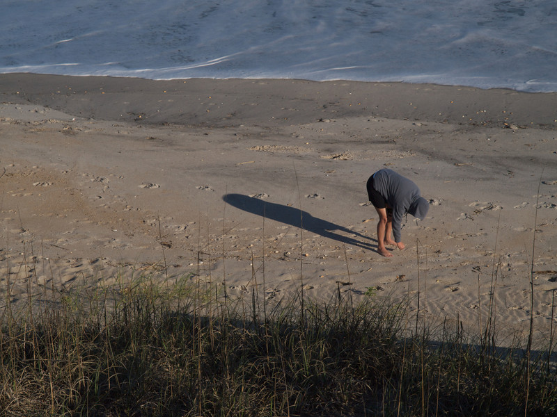 Lesley looking for shells and sharks' teeth. Topsail Island, North Carolina.