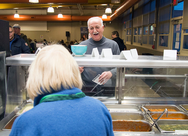 01/30/20 Wesley Bunnell | StaffrrThe annual SOUPerBowl to benefit the Friendship Centers Soup Kitchen took place on Thursday Jan 30, 2020 at E.C. Goodwin Technical School. Dennis Escernia smiles as his bowl of soup is poured.