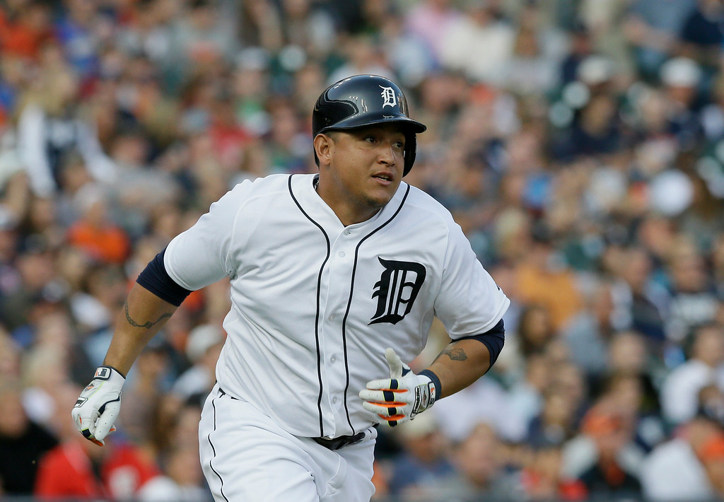 . Detroit Tigers\' Miguel Cabrera hits a double during the first inning of a baseball game against the Seattle Mariners, Friday, Aug. 15, 2014 in Detroit. (AP Photo/Carlos Osorio)