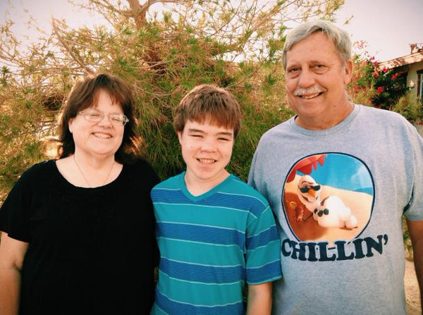 Retired Navy corpsman Lloyd Tilch (right) and his family partnered in November 2014 to build a new home with the Desert Communities Fuller Center for Housing in Twentynine Palms, Calif. Lloyd's wife Debbie (left) is fighting cancer, while their grandson Cody suffers from a litany of medical issues.