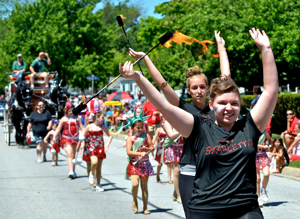. Jeff Forman/JForman@News-Herald.com The TNT Starlettes march in the Mentor Headlands July 4th Parade.