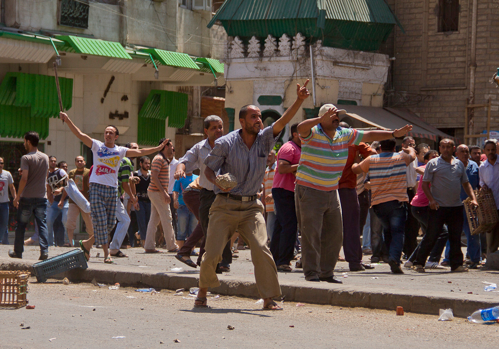 . Egyptian opposition protestors hold stones and sticks during clashes with supporters of President Mohamed Morsi in the northern port city of Damietta on June 3, 2013. Egyptian security forces imposed a travel ban on President Mohamed Morsi and several top Islamist allies over their involvement in a prison escape in 2011, security officials said. AFP PHOTO / STRSTR/AFP/Getty Images