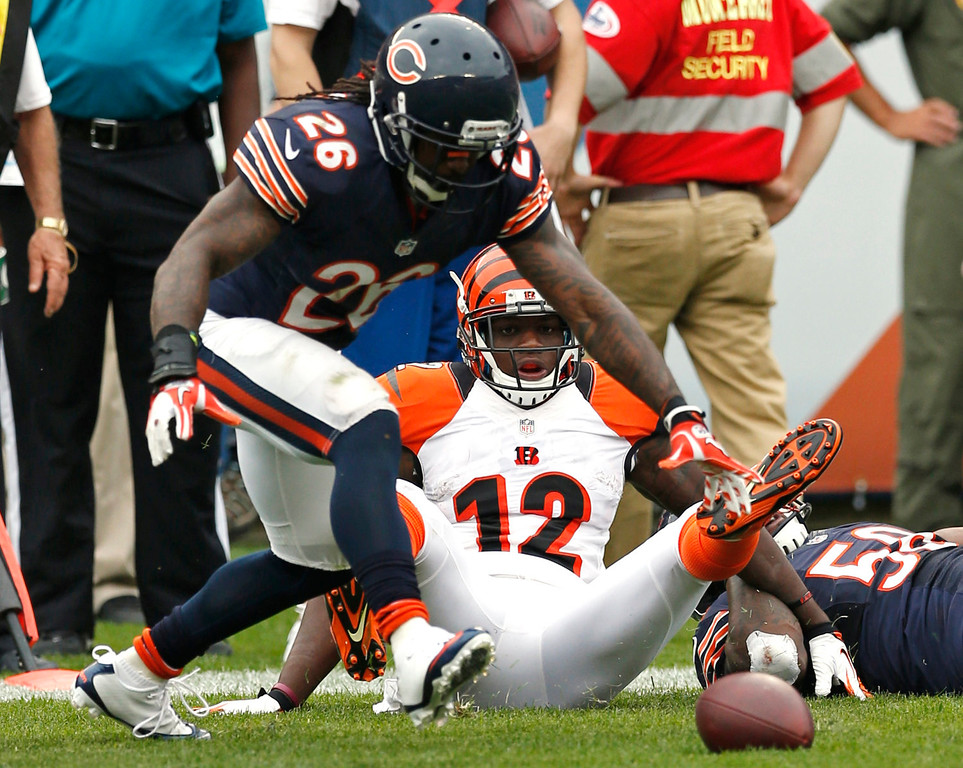 . Cincinnati Bengals wide receiver Mohamed Sanu (12) watches his fumble as Chicago Bears cornerback Tim Jennings (26) recovers it during the second half of an NFL football game, Sunday, Sept. 8, 2013, in Chicago. The Bears won 24-21. (AP Photo/Charles Rex Arbogast)