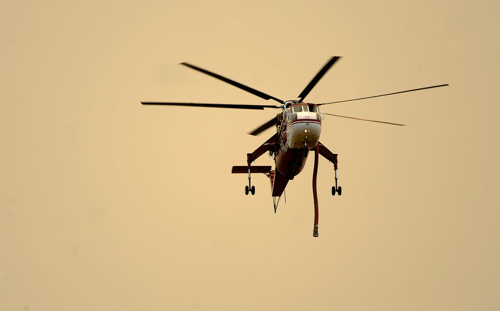 . A helicopter surveys the fire. The High Park fire northwest of Fort Collins continues to burn today June 10th, 2012.  The fire is now estimated at over 14,000 acres and still zero percent containment. Helen H. Richardson, The Denver Post