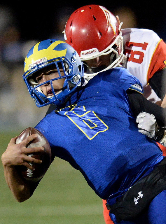 . San Dimas quarterback Josh Avila (6) scrambles as Paraclete\'s Chad Hall (81) makes the tackle in the first half of a CIF-SS Mid-Valley Division championship football game at San Dimas High School in San Dimas, Calif., on Friday, Dec. 6, 2013.   (Keith Birmingham Pasadena Star-News)