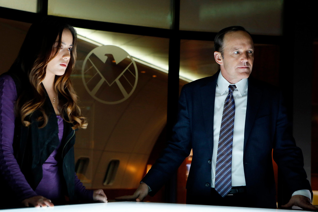 """. MARVEL\'S AGENTS OF S.H.I.E.L.D. - \""""Pilot\"""" - Joss Whedon, the creative genius behind the feature film \""""Marvel\'s The Avengers,\"""" one of the highest grossing films of all time, and of the iconic television series \""""Buffy The Vampire Slayer,\"""" has co-created \""""Marvel\'s Agents of S.H.I.E.L.D.,\"""" a dynamic, action-packed one-hour drama that brings back Agent Phil Coulson (Clark Gregg) to lead a team of highly skilled agents to investigate extra-normal and super human people and events worldwide.  (ABC/Justin Lubin) CHLOE BENNET, CLARK GREGG"""