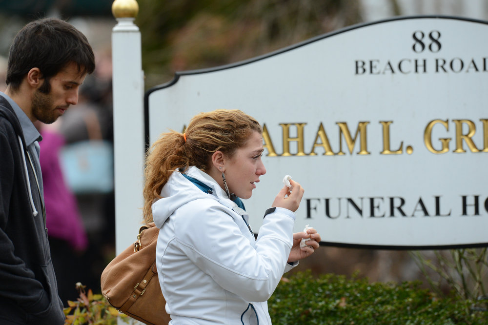 . Mourners leave after the funeral of Noah Pozner December 17, 2012 at the Abraham L. Green and Son Funeral Home in Fairfield, Connecticut. Pozner, a six year-old Jewish boy who, along with 19 other classmates and 6 teachers was murdered by a lone gunman December 14 at the Sandy Hook Elementary School in Newtown, Connecticut.  AFP PHOTO / Don  EMMERT/AFP/Getty Images