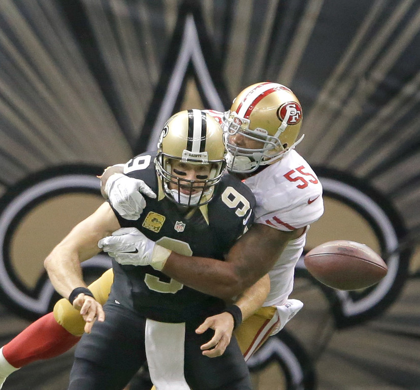 . New Orleans Saints quarterback Drew Brees (9) is about to be sacked by San Francisco 49ers outside linebacker Ahmad Brooks (55) during an NFL football game at the Superdome in New Orleans, Sunday, Nov. 9, 2014. (AP Photo/NOLA.com The Times-Picayune, David Grunfeld)