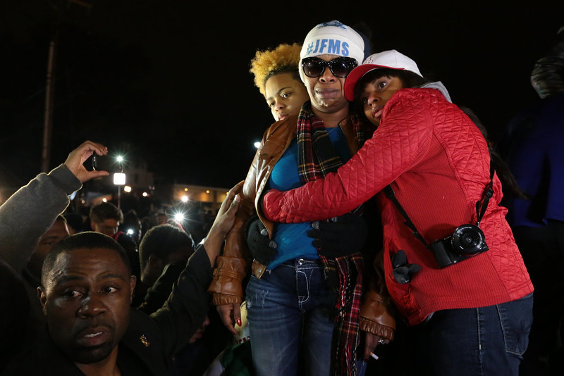 . Lesley McSpadden, Michael Brown\'s mother, is comforted outside the Ferguson police department as St. Louis County Prosecutor Robert McCulloch conveys the grand jury\'s decision not to indict Ferguson police officer Darren Wilson in the shooting death of her son, Monday, Nov. 24, 2014 in Ferguson, Mo. (AP Photo/The St. Louis Post-Dispatch, Robert Cohen)
