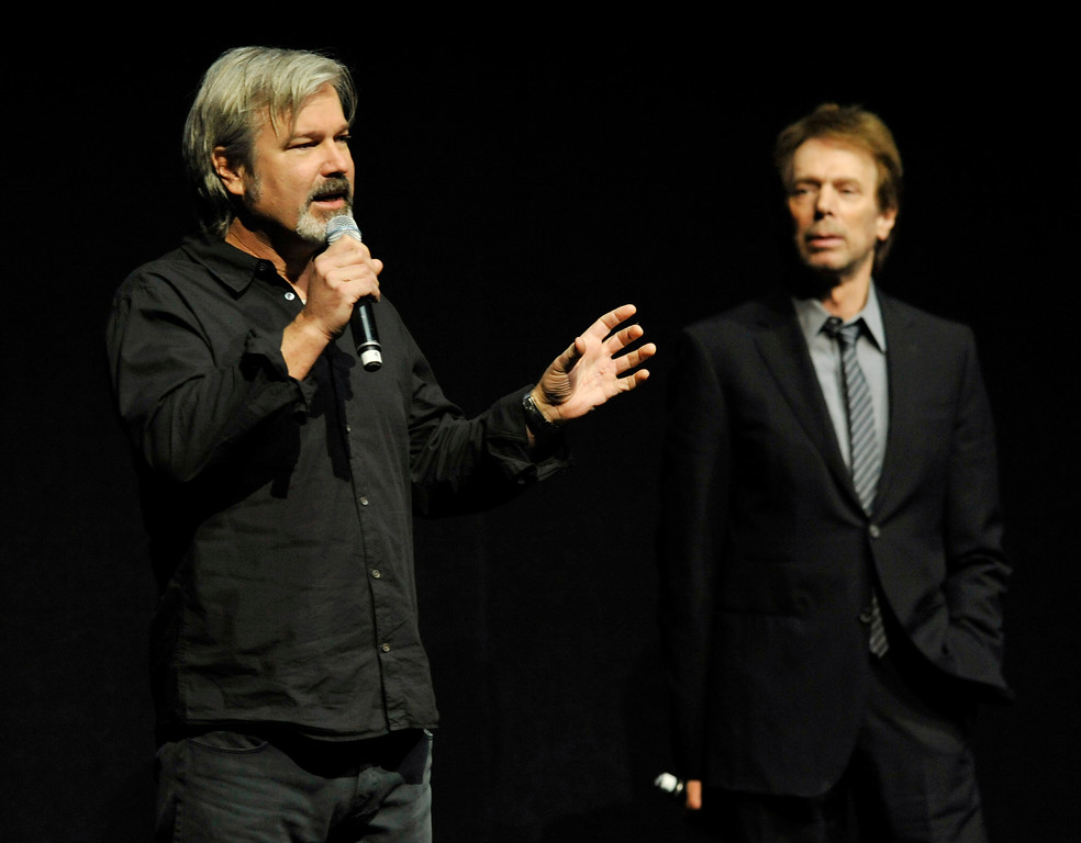 ". Gore Verbinski, left, director of the upcoming film ""The Lone Ranger,\"" addresses the audience as the film\'s producer Jerry Bruckheimer looks on during the Walt Disney Studios presentation at CinemaCon 2013 at Caesars Palace on Wednesday, April 17, 2013 in Las Vegas. (Photo by Chris Pizzello/Invision/AP)"