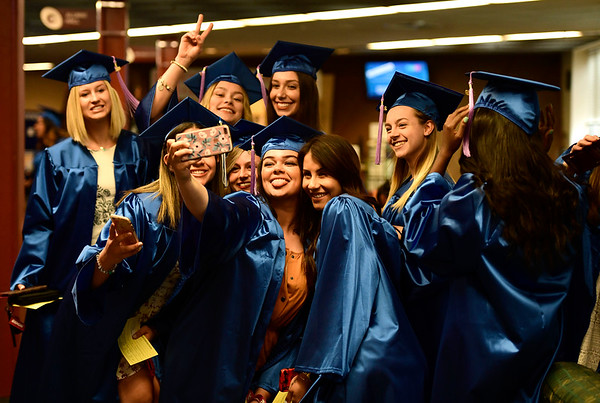 5/30/2019 Mike Orazzi | Staff Tunxis students gather at CCSU for Thursday night's graduation ceremony in New Britain.