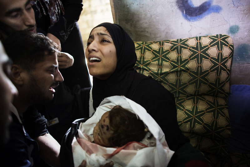 . The mother of 10-month-old Palestinian girl, Hanen Tafesh, killed the day before in an Israeli air strike, mourns over her body before her funeral in Gaza City, on November 16, 2012. Israeli warplanes carried out multiple new air strikes on the Palestinian territory, including several hits on Gaza City, the third day of an intensive campaign which the military has said is aimed at stamping out rocket fire on southern Israel. MARCO LONGARI/AFP/Getty Images