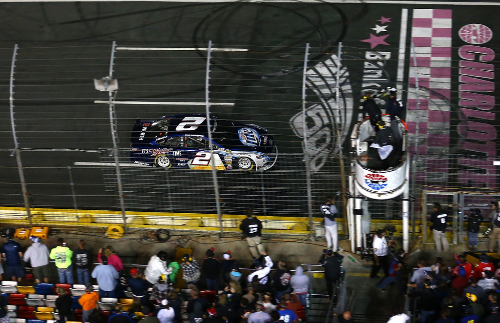 . CONCORD, NC - OCTOBER 12:  Brad Keselowski, driver of the #2 Miller Lite Ford, takes the checkered flag to win the NASCAR Sprint Cup Series Bank of America 500 at Charlotte Motor Speedway on October 12, 2013 in Concord, North Carolina.  (Photo by Streeter Lecka/Getty Images)