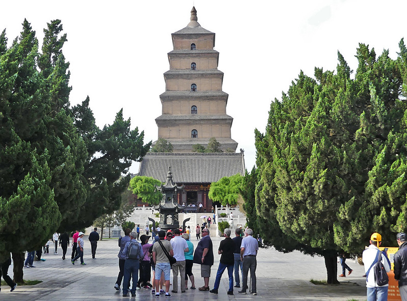 This Giant Wild Goose Pagoda standing at  64 m tall with seven stories at present  was originally built  during Tang dynasty (652) with five stories-  54 m in height. Collapsed five decades later and rebuilt in 704 during  reign of Empress Wu Zetian who repaired it and added five more stories. 1556 massive earthquake destroyed three stories to the present seven. This Pagoda holds sutras and figurines of the Buddha that were brought to China from India by the Buddhist translator and traveler Xuanzang.