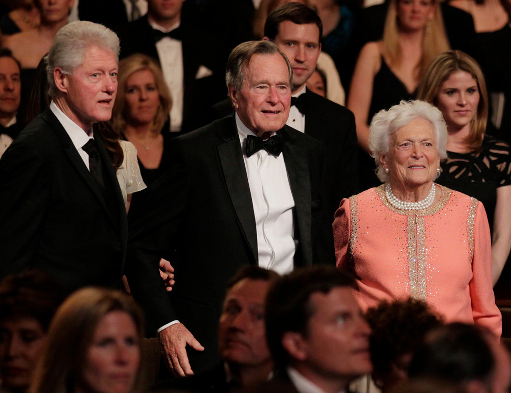 ". From left, former President Bill Clinton, former President George H. W. Bush and his wife Barbara Bush stand for the National Anthem at the Kennedy Center, Monday, March 21, 2011, in Washington, before the ""All Together Now - A Celebration of Service\"" performance in honor of former President George H. W. Bush.  (AP Photo/Carolyn Kaster)"