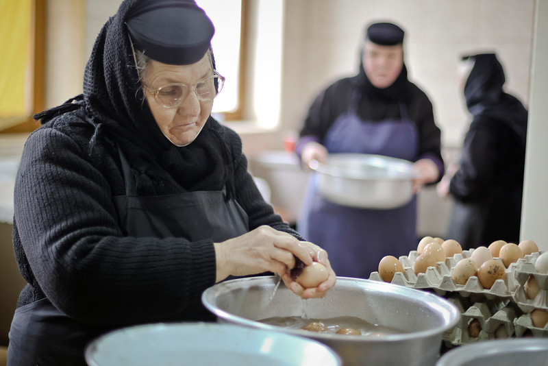 . An Orthodox nun washes eggs at the Timiseni Monastery, outside Sag, western Romania, Friday, April 18, 2014.  Nuns painted 1,000 eggs for the upcoming Easter celebrations, following an ancient method for obtaining the color from boiled red onions.(AP Photo/Adi Piclisan)