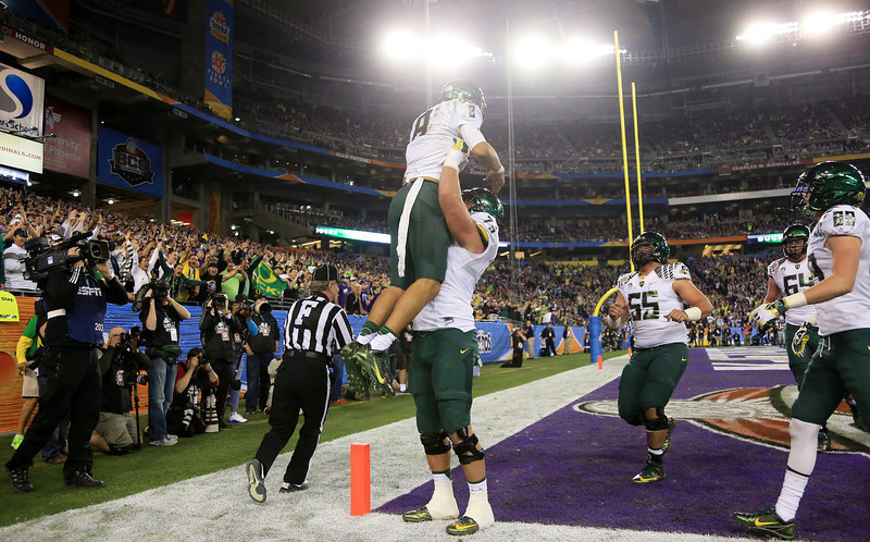 . Marcus Mariota #8 celebrates his third quarter touchdown with Jake Fisher #75 of the Oregon Ducks during the Tostitos Fiesta Bowl against the Kansas State Wildcats at University of Phoenix Stadium on January 3, 2013 in Glendale, Arizona.  (Photo by Doug Pensinger/Getty Images)