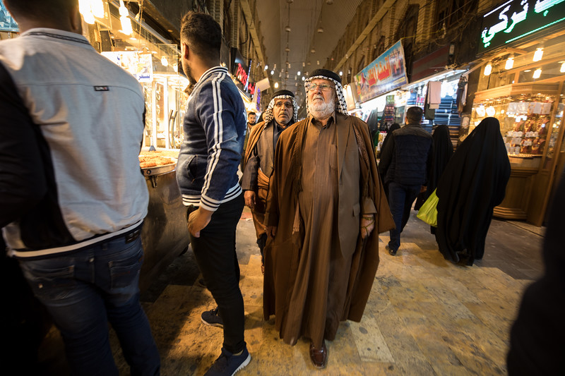 Iraqi men wearing the Dishdāshah black and white checked Keffiyeh in Najaf souq.