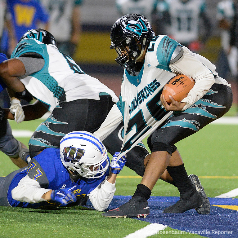 . Will C. Wood defensive lineman, Agustin Miranda grabs a handful of Deer Valley quarterback, Joshua Scott\'s jersey as he works to sack him during the third quarter.