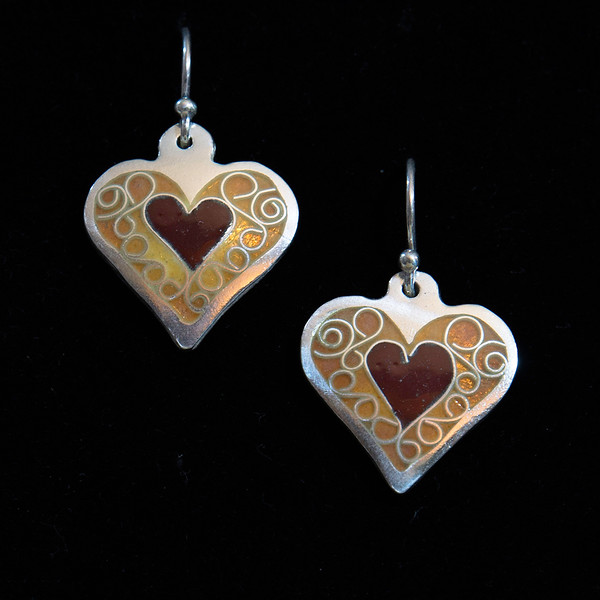 Fine Silver Champlevé and Cloisonné tiny red heart earrings. Measuring 1 inch long, 3/4 inches wide. Drop from earwire is approximately 1 3/8 inches. Sterling Silver earwires. 95.00