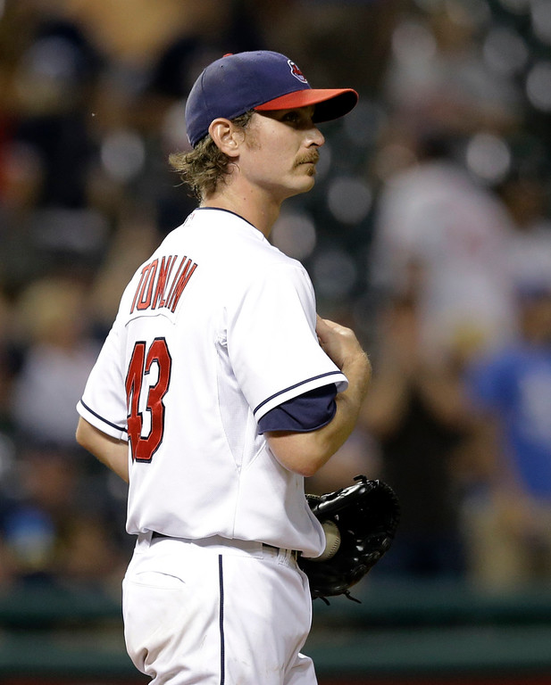 . Cleveland Indians relief pitcher Josh Tomlin watches a three-run home run by Detroit Tigers\' Victor Martinez in the 11th inning of a baseball game, Thursday, Sept. 4, 2014, in Cleveland. The Tigers defeated the Indians 11-4. (AP Photo/Tony Dejak)