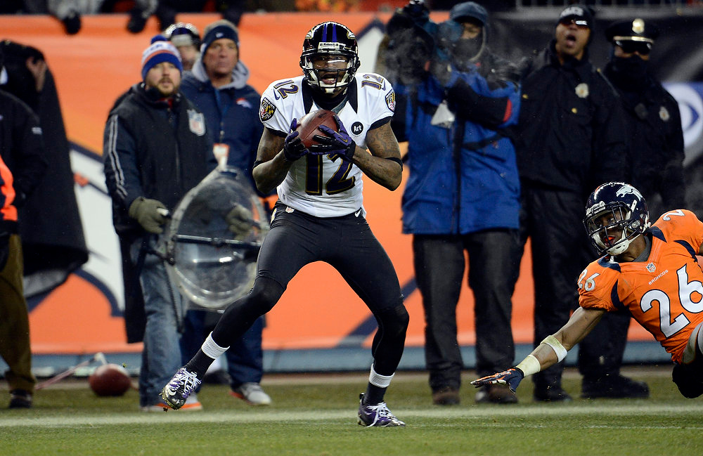 Description of . Baltimore Ravens wide receiver Jacoby Jones (12) scores a touchdown late in the fourth quarter sending the game into overtime.  The Denver Broncos vs Baltimore Ravens AFC Divisional playoff game at Sports Authority Field Saturday January 12, 2013. (Photo by John Leyba,/The Denver Post)