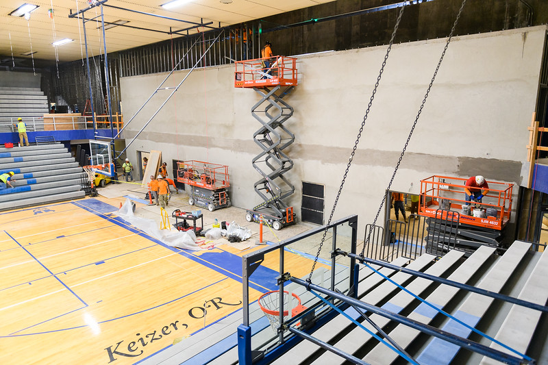 New cement wall under construction in the McNary High School gymnasium on Friday, August 16, 2019, in Keizer, Ore.