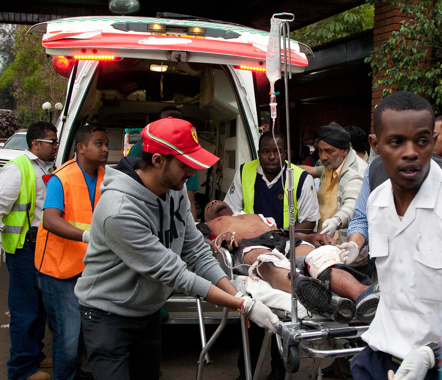 . An injured person arrives in an ambulance at the Aga Khan Hospital in Nairobi after an attack at the Westgate Mall, an upscale shopping mall in Nairobi, Kenya Saturday Sept. 21, 2013, where shooting erupted when armed men staged an attack. (AP Photo/Jason Straziuso)