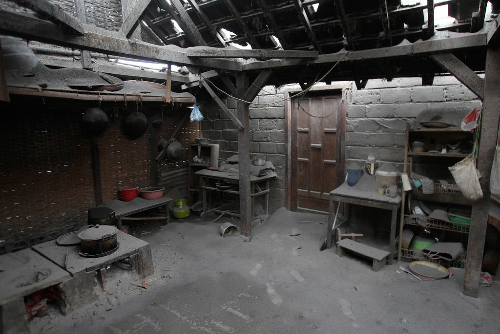 . The kitchen room of a house is covered with ash after an eruption of Mount Kelud, in Malang, East Java, Indonesia, Sunday, Feb. 16, 2014.  (AP Photo/Trisnadi)