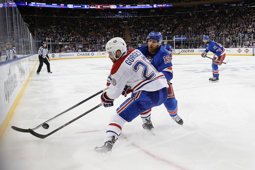 . Montreal Canadiens defenseman Josh Gorges (26) battles for the puck against the boards with New York Rangers center Brad Richards (19) during the second period in Game 6 of the NHL hockey Stanley Cup playoffs Eastern Conference finals, Thursday, May 29, 2014, in New York. (AP Photo/Kathy Willens)