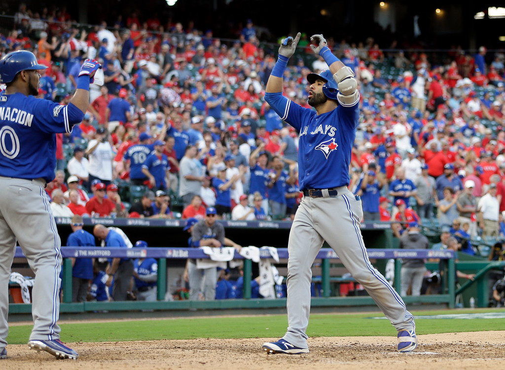 . Toronto Blue Jays\' Edwin Encarnacion, left, and Jose Bautista, right, celebrate a three-run home run by Bautista in the ninth inning against the Texas Rangers in Game 1 of baseball\'s American League Division Series, Thursday, Oct. 6, 2016, in Arlington, Texas. (AP Photo/David J. Phillip)