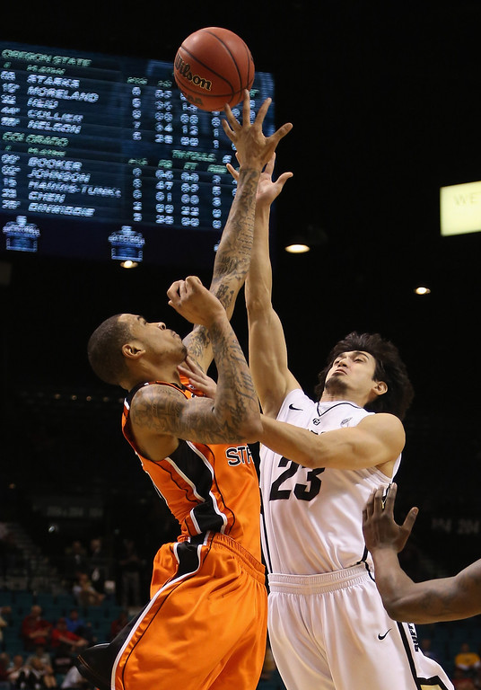 . LAS VEGAS, NV - MARCH 13:  Sabatino Chen #23 of the Colorado Buffaloes is blocked by Eric Moreland #15 of the Oregon State Beavers in the first half during the first round of the Pac 12 Tournament at the MGM Grand Garden Arena on March 13, 2013 in Las Vegas, Nevada. Colorado defeated Oregon State 74-68.  (Photo by Jeff Gross/Getty Images)