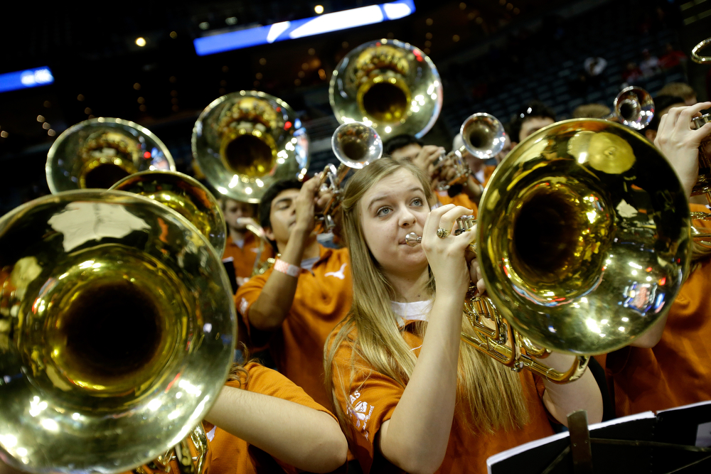 Description of . The Texas Longhorns band performs against the Michigan Wolverines during the third round of the 2014 NCAA Men's Basketball Tournament at BMO Harris Bradley Center on March 22, 2014 in Milwaukee, Wisconsin.  (Photo by Mike McGinnis/Getty Images)