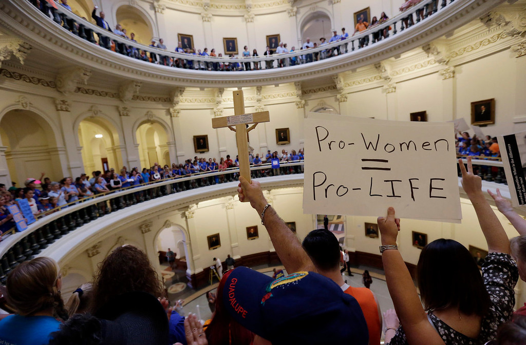 . Anti-abortion supporters and pro-abortion rights supporters crowd into the rotunda of the Texas capitol, Monday, July 1, 2013, in Austin, Texas. The Texas Senate has convened for a new 30-day special session to take up a contentious abortion restrictions bill and other issues. (AP Photo/Eric Gay)