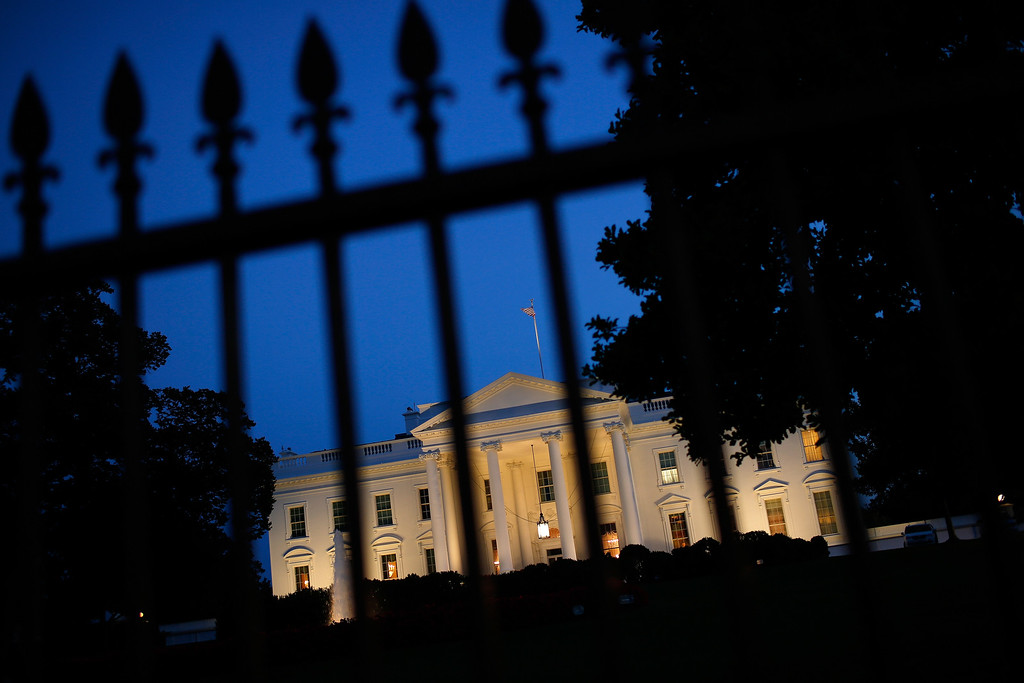""". WASHINGTON, DC - SEPTEMBER 10:  The White House is lit at dusk shortly before U.S. President Barack Obama is scheduled to address the nation September 10, 2014 in Washington, DC. Obama is expected to speak on military measures the United States intends to conduct to combat Islamic militants \""""wherever they exist.\""""  (Photo by Win McNamee/Getty Images)"""