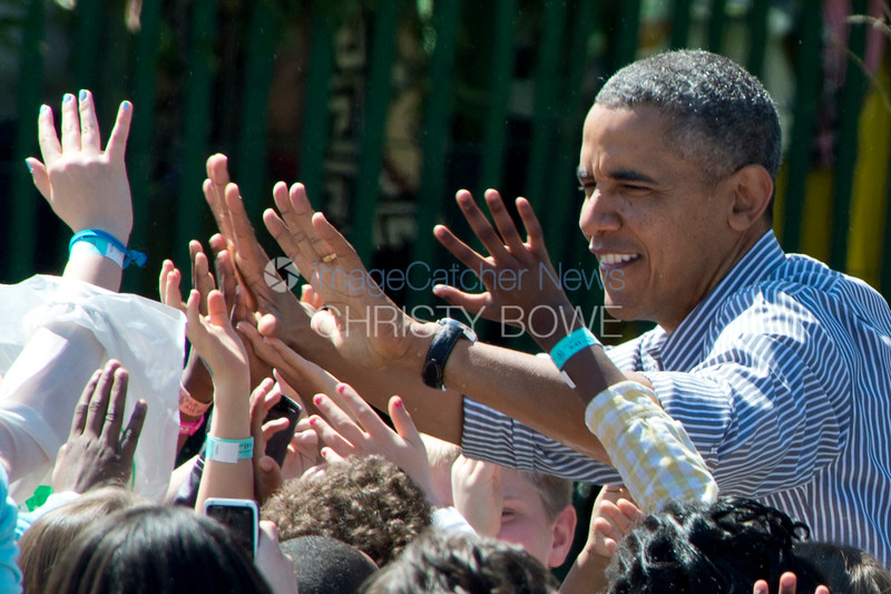 President Barack Obama high fives kids during the  2014 Easter Egg Roll at the White House.