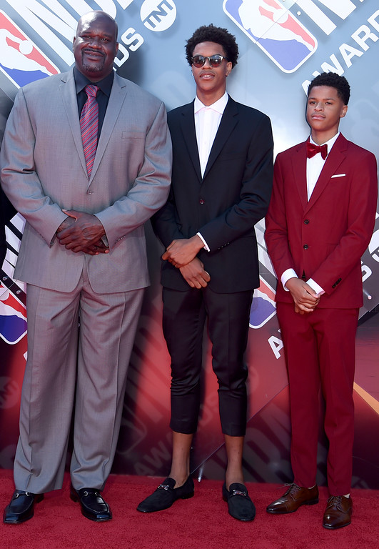 . Shaquille O\'Neal, from left, and his sons Shareef O\'Neal and Shaqir O\'Neal arrive at the NBA Awards on Monday, June 25, 2018, at the Barker Hangar in Santa Monica, Calif. (Photo by Richard Shotwell/Invision/AP)