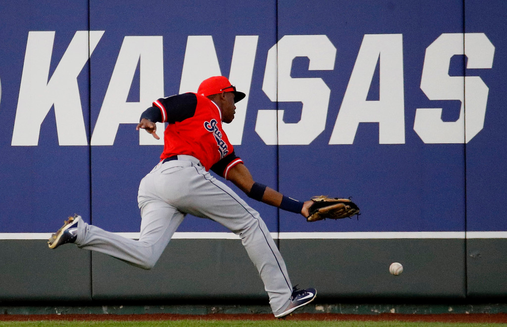 . Cleveland Indians center fielder Greg Allen chases a double hit by Kansas City Royals\' Salvador Perez during the fourth inning of a baseball game Saturday, Aug. 25, 2018, in Kansas City, Mo. (AP Photo/Charlie Riedel)